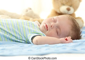 Single baby sleeping on a bed - Portrait of a single baby...