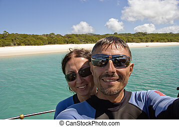 Young Couple having Fun in Whitehaven Beach, Queensland,...