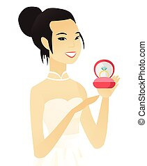Young asian bride holding a wedding ring in a box. - Asian...