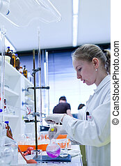 portrait of a female researcher carrying out research in a...