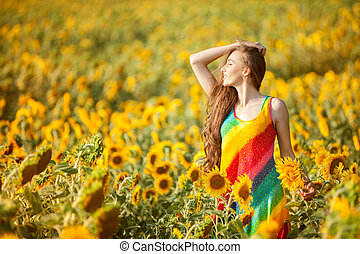 Girl in the yellow field of sunflowers. - Girl on a yellow...