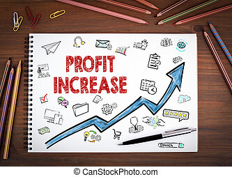Profit Increase, Business Concept. Notebooks, pen and colored pencils on a wooden table