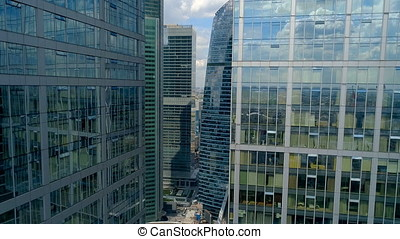 Flying among downtown commercial district skyscrapers. -...