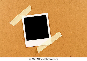 Blank instant photo print with sticky tape