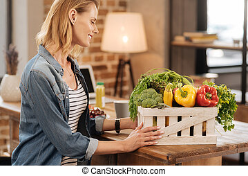 Active lively woman enjoying perfect set of vegetables