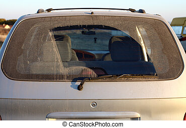 wiper - The dirty back window of an automobile