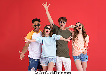 Cheerful group of friends standing isolated - Image of young...