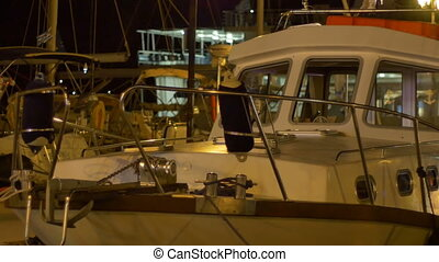 Night Harbor Speedboat - Bow view of a speedboat in the...