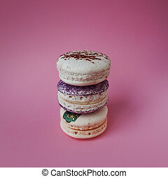 Macarons on pink background, Beautiful dessert three things in column