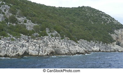Close to Greek Rocky Seashore - Rear view by travelling boat...