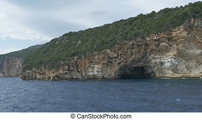 Caves Along Seashore - Travelling by the sea along a cave in...