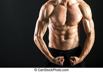 Strong muscular torso of young sexy man