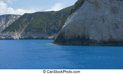 Rocky Greek Seashore - Beautiful blue sea on the Greece...