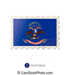 Postage stamp with the image of North Dakota state flag....