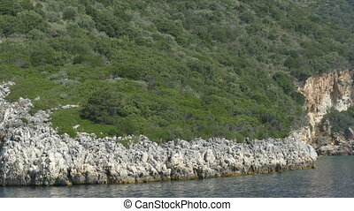 Rocky Sea Shore - Cruising near the shoreline and the sharp...