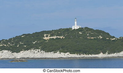 Lighthouse at Shore - Greek lighthouse on an island.