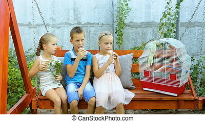 Happy children eating appetizingly ice-cream