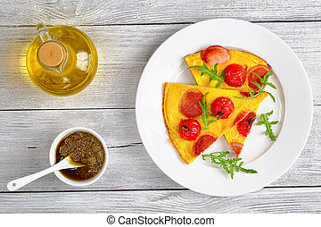 portion of omelette with sausages and tomato - portion of...