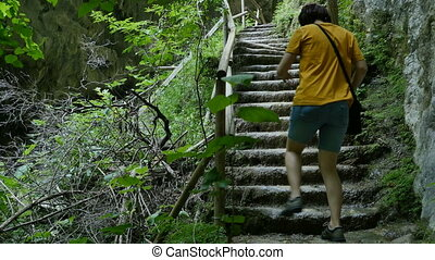Woman Climbing Wet Stairs - Tourist girls is climbing wet...