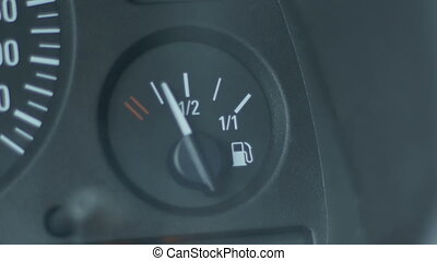 Fuel Gauge of a Car - Fuel gauge pointer  of a car rising .