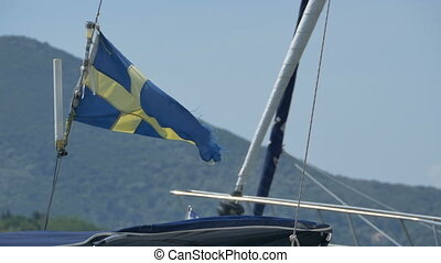 Sweden Torn Flag on Ship - Sweden flag on a yacht masy...