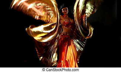Arabic woman dancer with gold wing