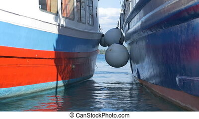 Large Ship Fenders - Large ships fender beetween boats in...