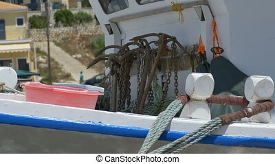 Rusty Anchors on Fishing Boats - A bunch of rusty anchors on...