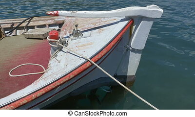 Old Fishing Boat Floating - Wood fishing boat mored in the...