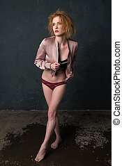 Redhead in pink and black - Pretty strawberry blonde woman...