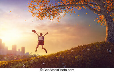 child jumping with book - Back to school! Happy cute...