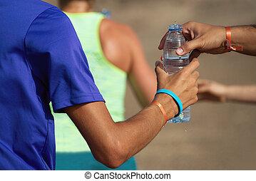 Drinks station at a trail running marathon