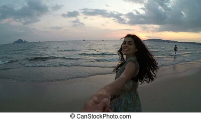 Young Woman Walking On Beach Holding Man Hand At Sunset Action Camera Point Of Vew Of Happy Smiling Girl On Seaside