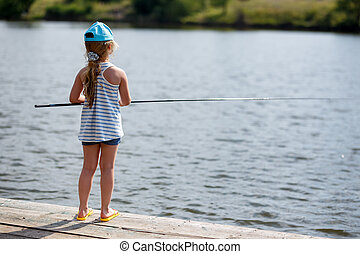 Girl fishing from a dock on a lake or pond.