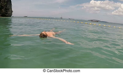 Man Swimming On Back In Sea Action Camera POV Of Young Guy...