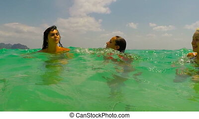 Three Girls Swimming In Sea Action Camera POV Of Young Woman...