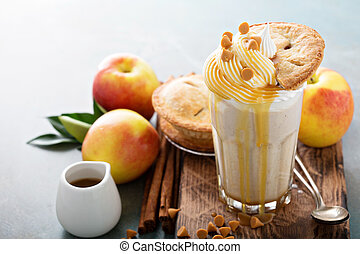 Apple pie milkshake with caramel syrup and a piece of pie