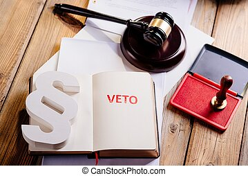 Red veto stamp in notepad - law office concept