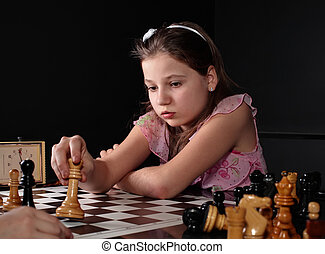 Check - Teenage girl 12-13 years old playing chess. Check