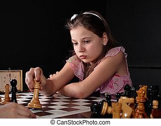 Check - Teenage girl 12-13 years old playing chess. Check