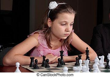 Teenage girl 12-13 years old playing chess