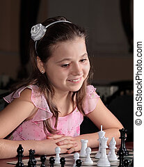 Teenage girl 12-13 years old playing chess