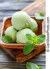 Homemade mint ice cream. - Mint ice cream in a wooden bowl...