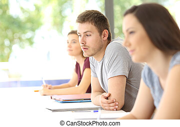 Distracted student at classroom - Distracted student looking...