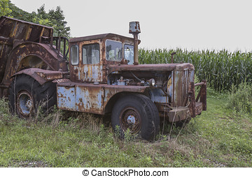 Cab of rusting farm truck in field - Rusting farm truck with...