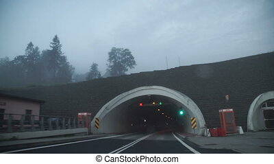 Driving car on coastal road through the tunnel