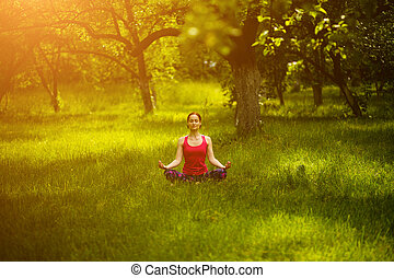 Woman relaxing in yoga pose Sukhasana. - Yoga practicing....