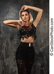 Stylish young woman in black lace top and skirt - Beautiful...