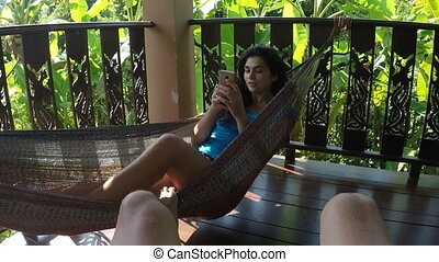 Man Swing Woman Lying In Hammock Texting With Cell Smart...
