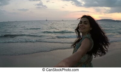 Young Woman Hold Male Hand Walking On Beach At Sunset Action Camera Point Of Vew Of Happy Smiling Girl On Seaside